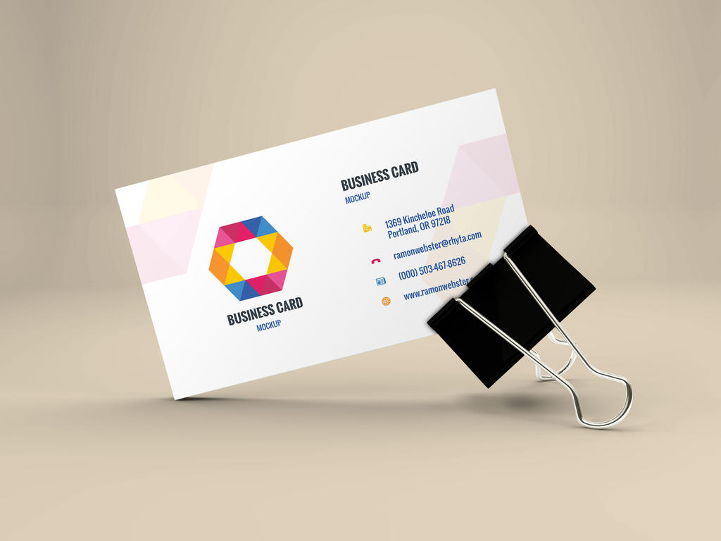 Freebie - Business Card Mockup In Binder Clip by GraphBerry