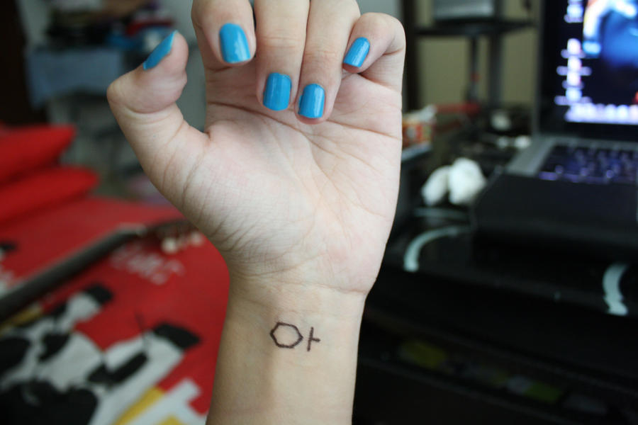 Tron: Legacy tattoo on wrist by angerawrrs