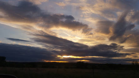 Cloudy Sunset by PandarenBabe