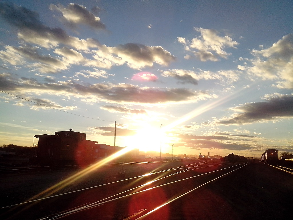 Sunset Over the Railyard by dinshino