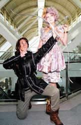 Katniss and Effie by TheOriginalAKTREZ