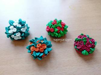 Tiny polymer clay rosebushes in bottlecaps