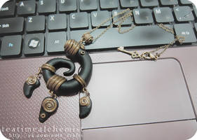 black and bronze clay pendant by tea-time-alchemist