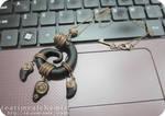 black and bronze clay pendant
