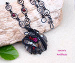 Black wire wrapped seashell pendant