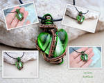 Green lampwork glass heart wire wrapped pendant