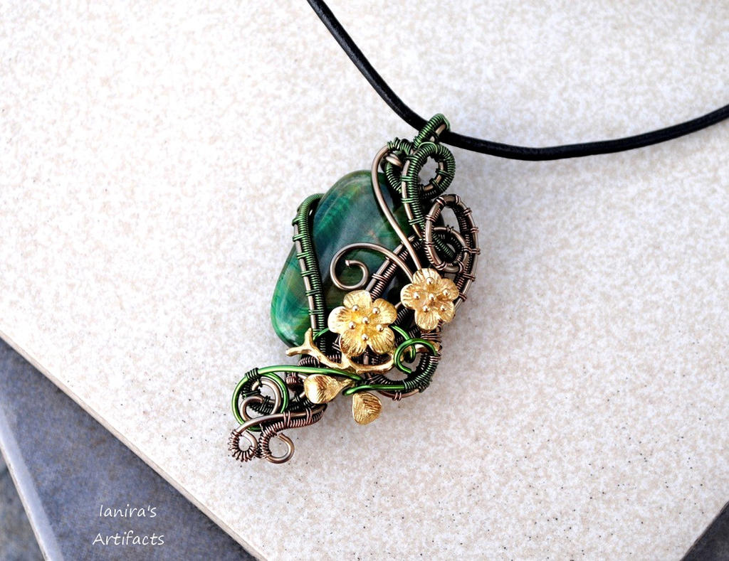 Green Tiger's Eye wire wrapped pendant by IanirasArtifacts