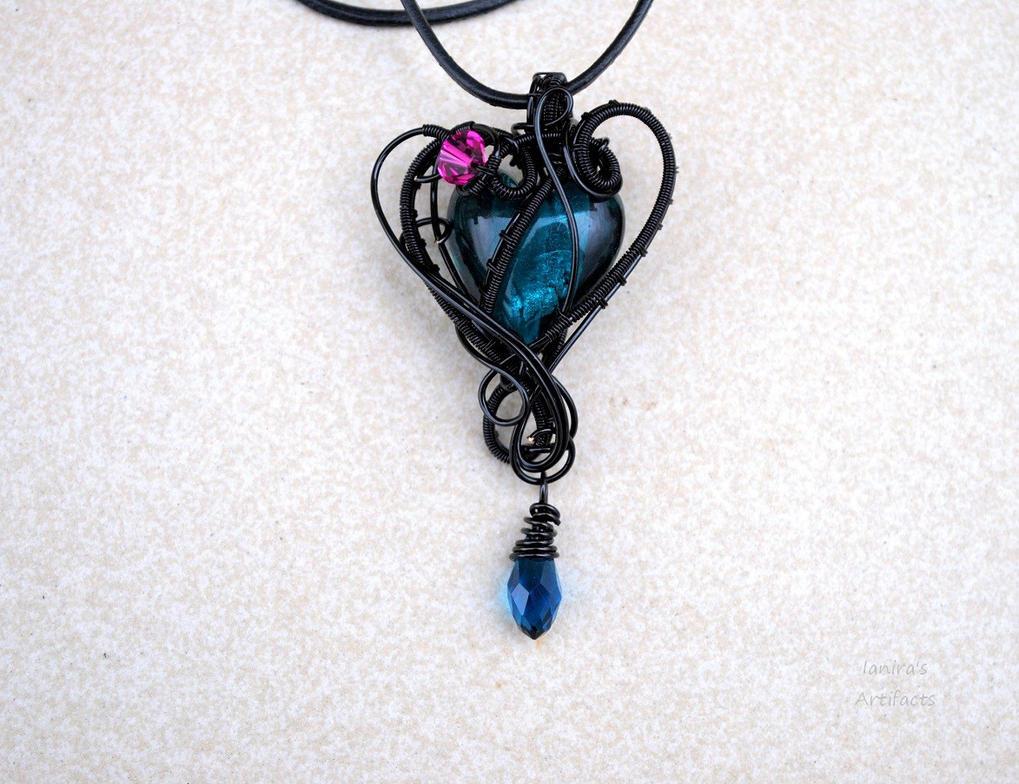 Turquoise lampwork glass heart pendant by IanirasArtifacts