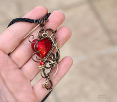 Red heart wire wrapped pendant - ooak by IanirasArtifacts