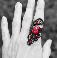 Black wire wrapped ring with red rose by IanirasArtifacts