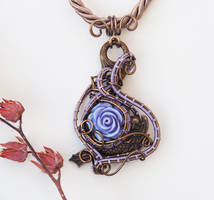 Lilac rose on a dolphin pendant