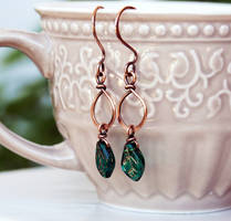 Antiqued copper wire drop earrings with green leaf