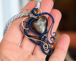 Navy blue and gold wire wrapped heart pendant