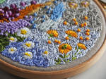 Abstract embroidery hoop art with daisies