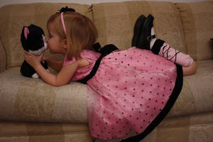 girl kissing kitty by LacyFaye