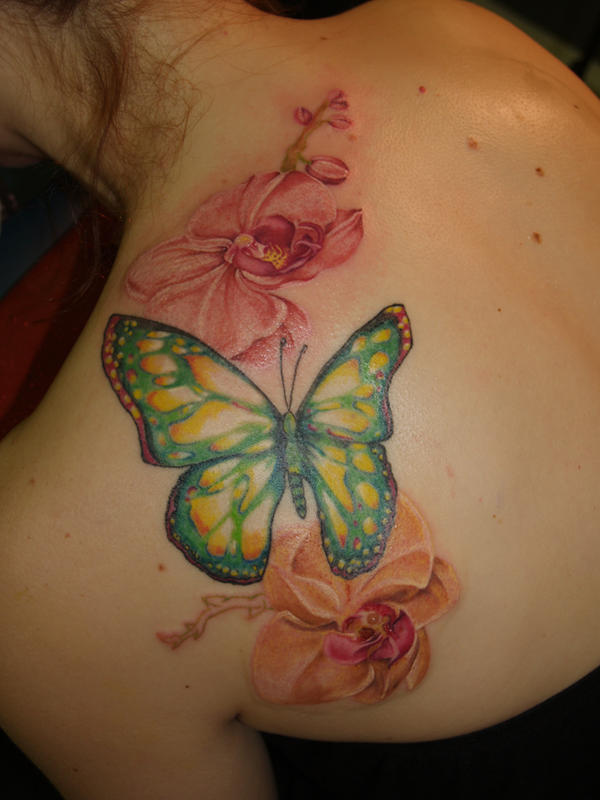 Orchids and butterfly tattoo