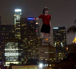 Taylor Swift Towering Over a City