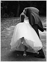 kissing teh bride