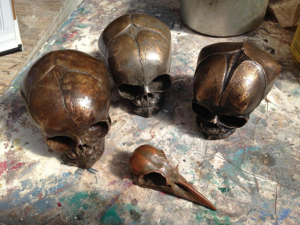 Bronze Skulls by MrSoles