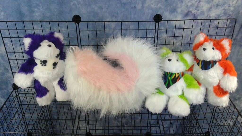 Husky tails and plushies by OurMassHysteria