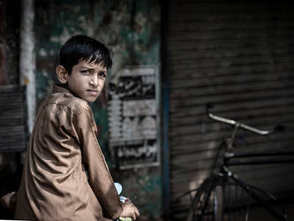 Boy At The Cycle Shop by InayatShah