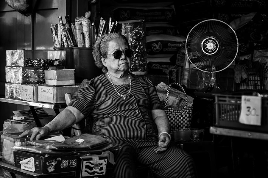 Chinatown Merchant - II by InayatShah