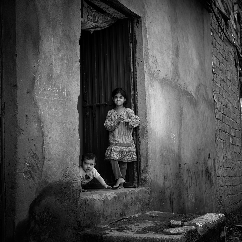 Girl And Baby In The Village
