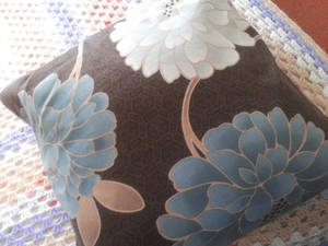brown and blue flowers cushion