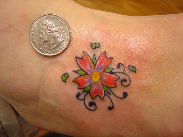 small flower tattoo. small flower tattoo