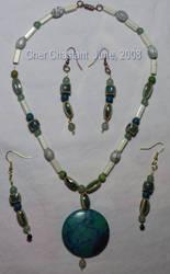 j - Turquoise Medallion by Catgoyle