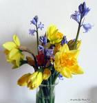Spring flowers in glass vase