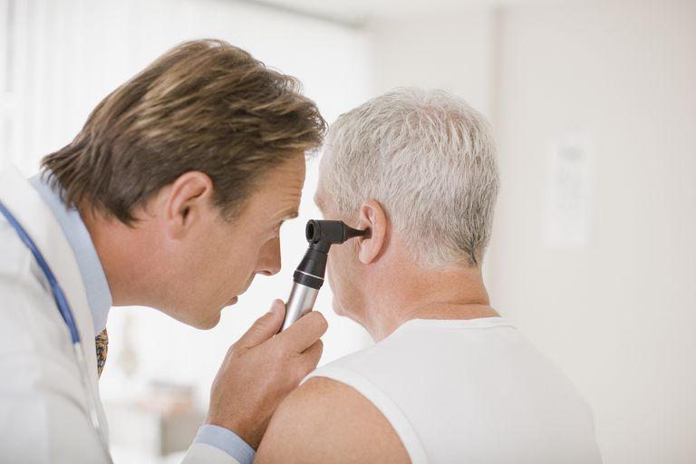 Doctor-examining-patients-ear-in-doctors-office-10