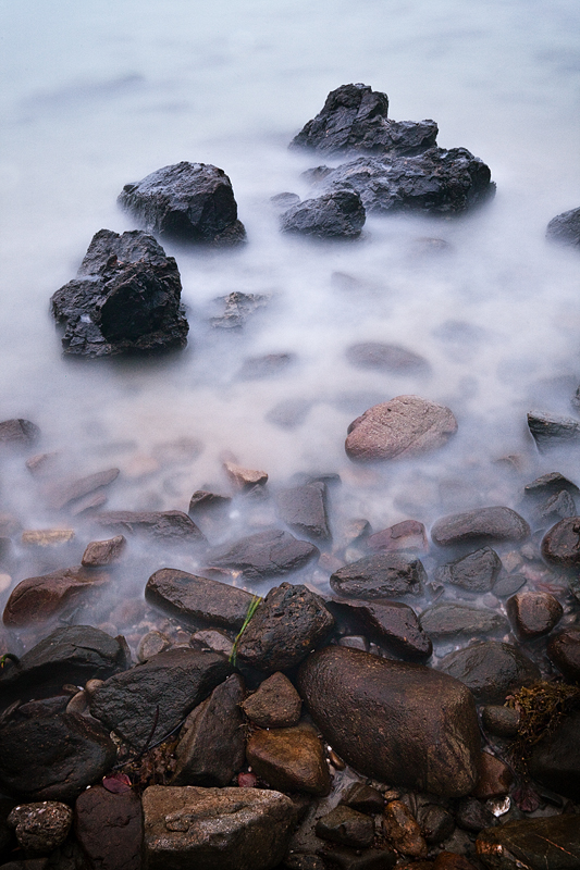 Long exposures are exelent for moving ocean waters splashing against rocks. The longer exposure = the more misty the scene looks.
