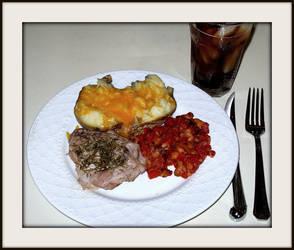 Rosemary pork chop, stewed tomatoes and potato by FallisPhoto
