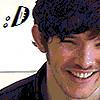 Colin's cute grin by WolfAngelDeath