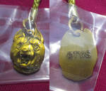 Golden-colored Gin charm