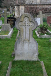 Old gothic grave with cross