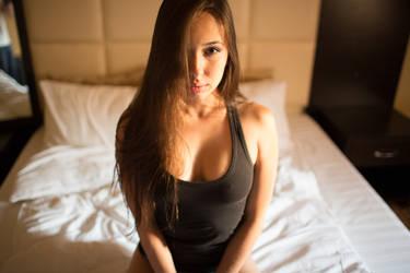 girl on bed by sergekrivoshei