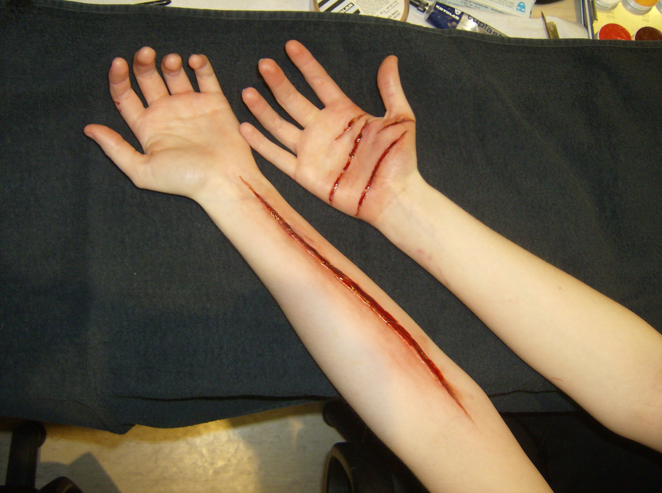 cut up hands and sliced arm by rosiedraper on deviantart