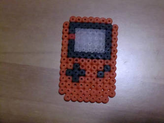 Mini orange game boy by Ziano87