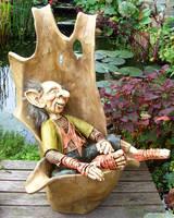 Troll in wooden chair