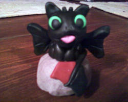 Toothless Clay Figurine