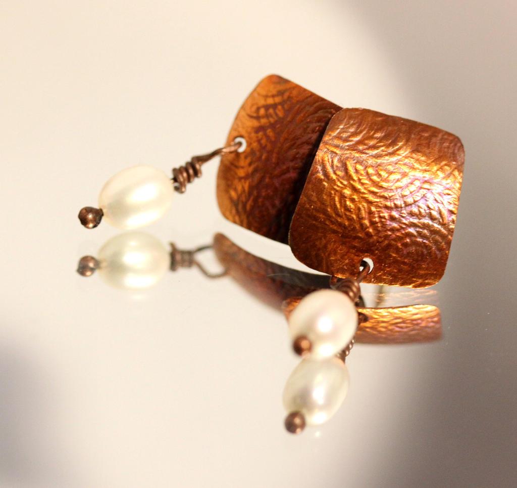 Embossed copper earrings by Ironmountain01