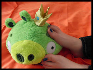 Happy feet playing w Angry Birds Golden King Pig