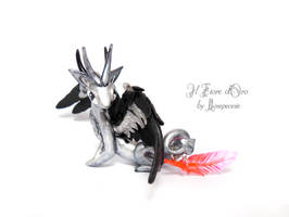 Silver Blackwing with feather by rosepeonie