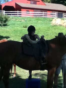 Me getting on a Horse