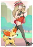 Pokemon trainer Serena with Fennekin.
