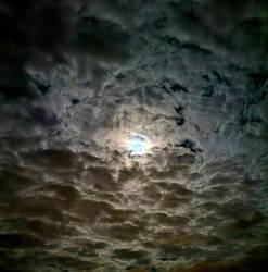 Moonlight Through Clouds