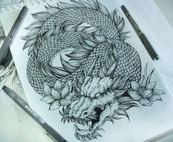 Shoulder dragon tattoo