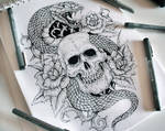 Snake and skull fore arm tattoo